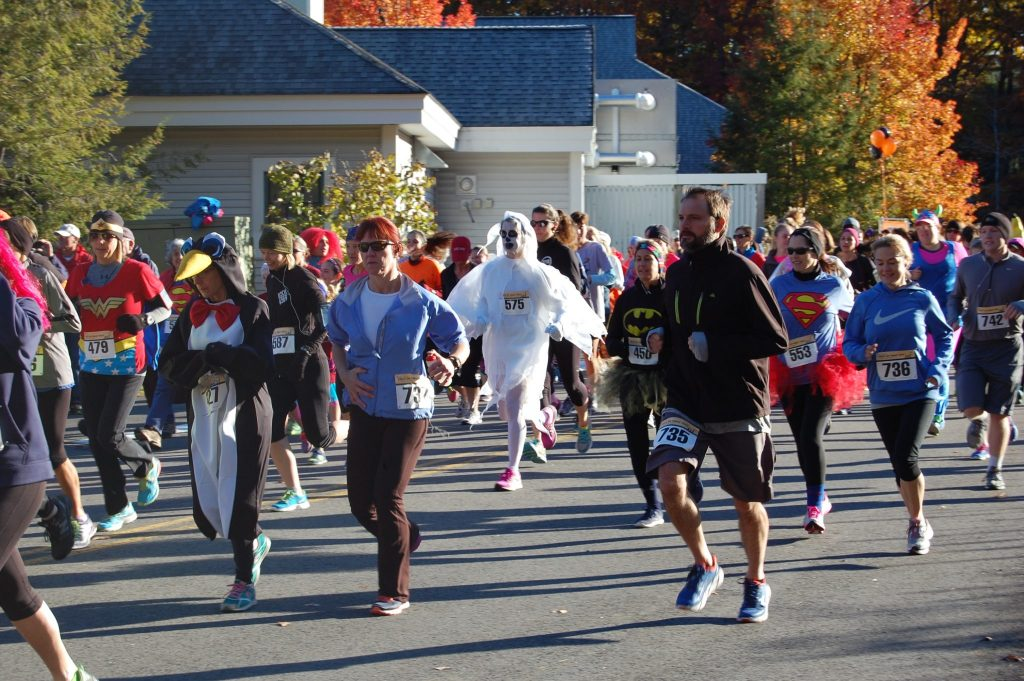 People in costume running the Exeter Hospital Trick or Treat Trot 5k
